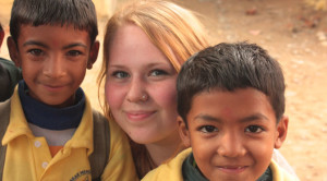 Volunteer with children in Nepal